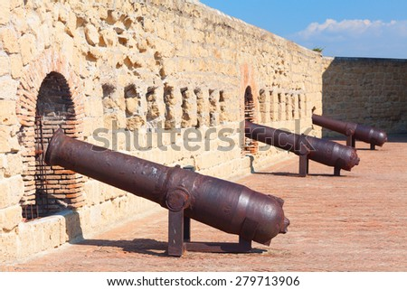 NAPLES, ITALY - OCTOBER 2012: Cannons of Castel dell'Ovo (Egg Castle) Naples, Italy. Roger II of Sicily built the castle in 1139. Now it is public museum with stunning panoramic view over the city.