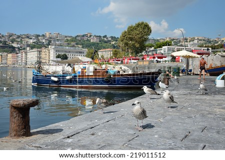 NAPLES - ITALY, SEPTEMBER 4: the last remaining few fishermen still do that every day the historic traditional market of fresh fish on the beach on september 4, 2014 in Naples