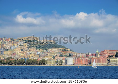 Naples, Italy - September 28, 2013 - View of Naples from the sea with sailboat