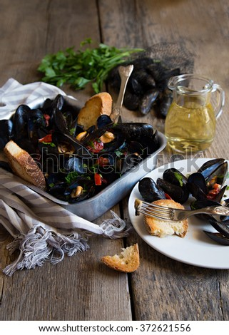 Naples style mussels with tomatoes - stock photo