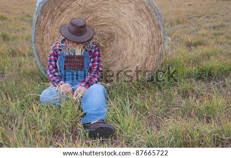 napping scarecrow - stock photo