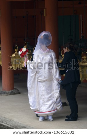 NARA, JAPAN - APRIL 5: Shinto wedding takes place at Kasuga Taisha shrine at April 5, 2013 in Nara, Japan. Most of the Japanese have Shinto wedding and Buddhist funeral to respect both religion.