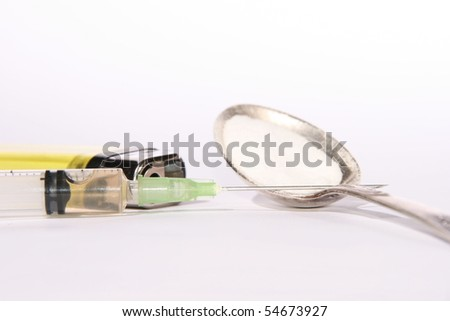 narcotic addiction concept: syringe, lighter and spoon with heroin - stock photo