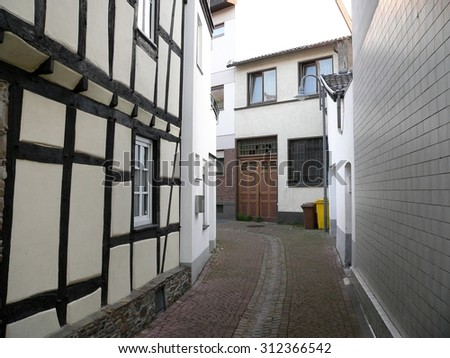 Narrow alley between tenement houses in Germany
