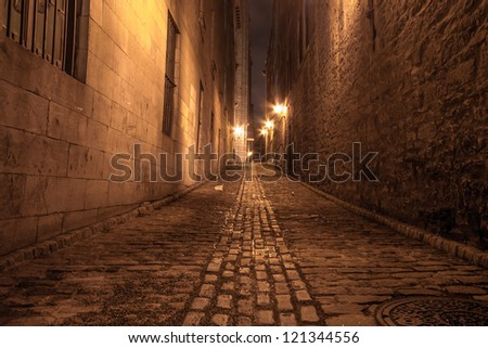 Narrow alley in Old Montreal at night. - stock photo