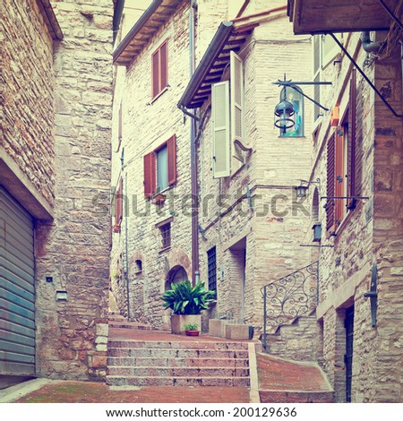 Narrow Alley with Old Buildings in Italian City of Assisi, Instagram Effect - stock photo