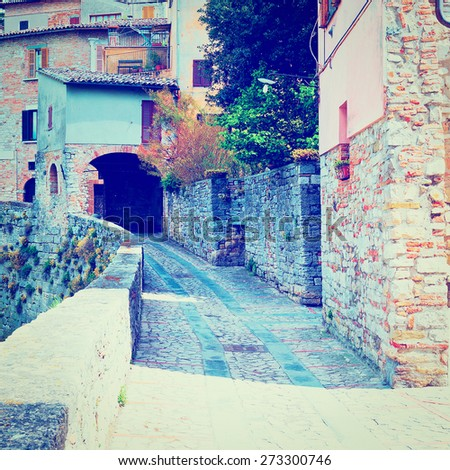 Narrow Alley with Old Buildings in Italian City of Doglio, Instagram Effect - stock photo