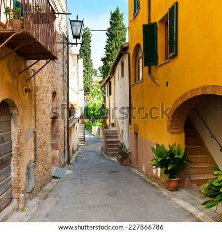 Narrow Alley with Old Buildings in the Chianti Region - stock photo