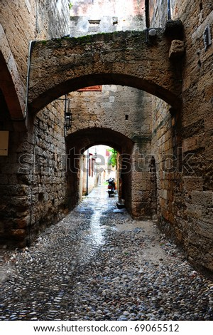 Narrow Alley With Old Buildings on Greece City of Rhodes - stock photo