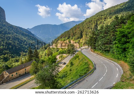 Narrow alpine road on French-Italian border in Alps, France (view from above). - stock photo