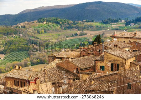 Narrow and winding streets of the small town of Tuscany, Montepulciano - stock photo