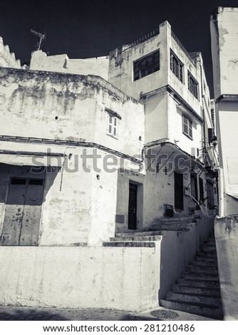Narrow Arabic streets, old Medina of Tangier, Morocco. Monochrome hi contrast filter effect - stock photo