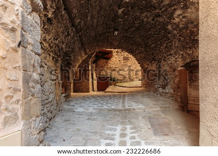 Narrow archway at the old street  in the village Coaraze, France - stock photo