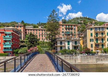 Narrow bridge and colorful buildings in town of Recco, Italy. - stock photo