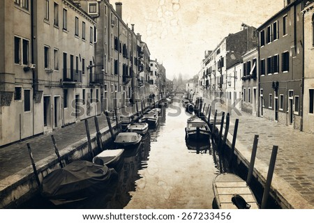 Narrow canal and embankment in Venice, Italy. Old buildings in raw stretched along the canal. Old photo effect applied. - stock photo