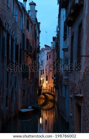 Narrow canal in Venice at  twilight , Italy. - stock photo