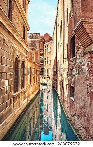 Narrow canal in Venice, Italy. - stock photo