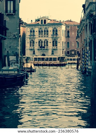 Narrow canal with vaporetto and Spinelli Palace in the background. Venice. Italy