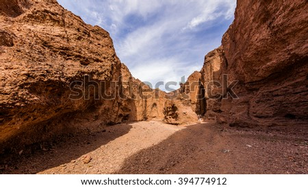 Narrow canyon with vertical walls on both sides. Sandstone formations in Natural bridge canyon trail, Death Valley - stock photo