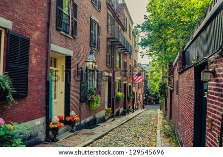 Narrow Cobbled Street and Red-Brick Houses in Boston - stock photo