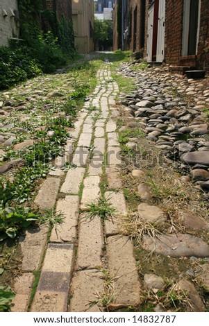 Narrow cobblestone road in old town, Alexandria, VA - stock photo