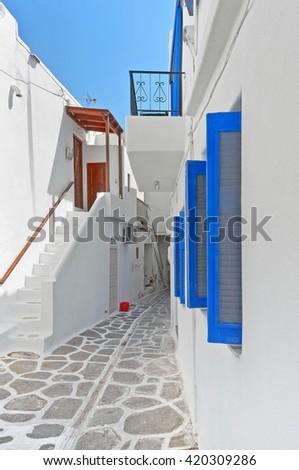 Narrow colorful street in old part of Parikia of Paros island Greece - stock photo