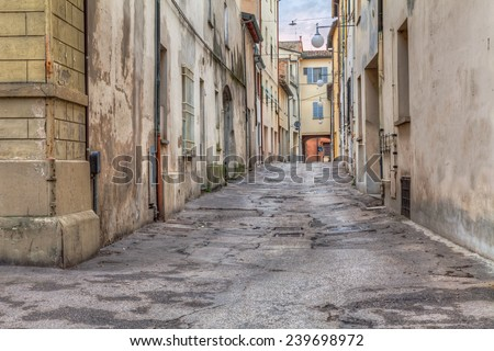 narrow dark alley in the old town - distressed alleyway in the italian city - urban decay, grunge aged street   - stock photo