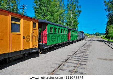 Narrow-gauge steam locomotive with an empty passenger car at the old station. Minkio, Finland - stock photo