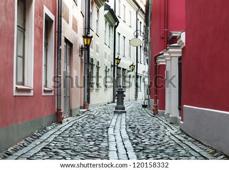 Narrow medieval street in old Riga, Latvia. In 2014, Riga city is the European capital of culture - stock photo