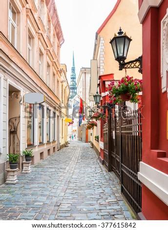 Narrow medieval street in old town Riga, Latvia  - stock photo