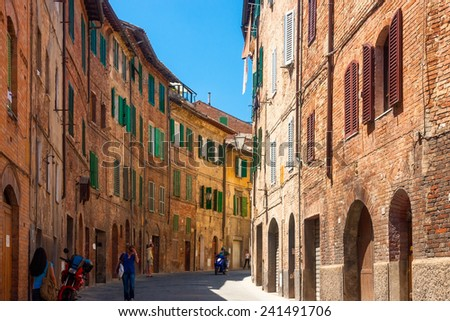 Narrow medieval street in Siena, Italy , - stock photo