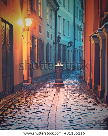 Narrow medieval street in the old Riga city, Latvia. Image toned for inspiration of retro style - stock photo