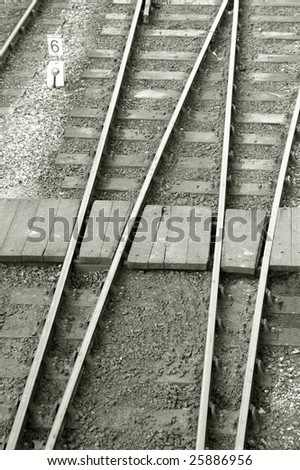 narrow pedestrian crossing over railroad tracks and points - stock photo