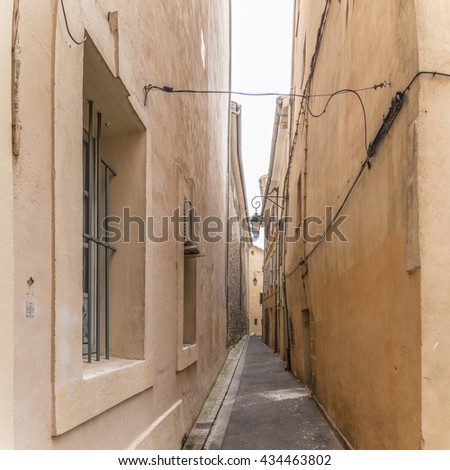 narrow road in the old town of Aix en Provence, France - stock photo