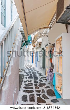 Narrow shopping lane in Mykonos old town, Greece, Europe - stock photo