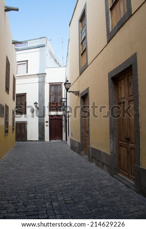 Narrow Side Street in Old City with Cobblestones - stock photo