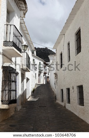 Narrow street in Andalusian village Bubion, Spain