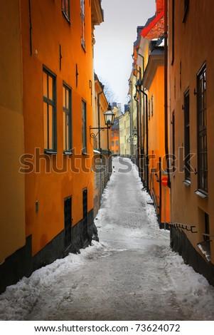 Narrow street in Gamla Stan, Stockholm - stock photo