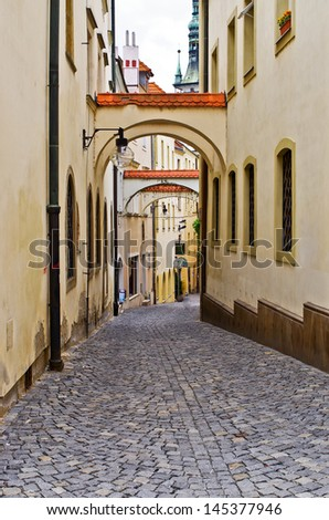 Narrow street in old European town - stock photo