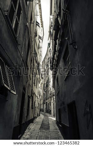 Narrow street in old town of Genova,port city in northern Italy - stock photo