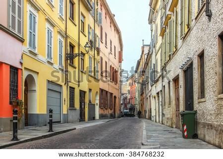 Narrow street in Parma, Emilia Romagna province, Italy. - stock photo