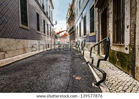 Narrow Street in the Midieval Alfama District of Lisbon, Portugal - stock photo