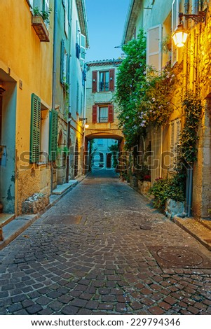Narrow street in the old town Antibes in France. Night view - stock photo