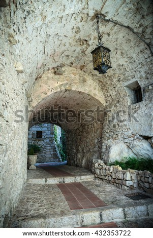 Narrow street in the old town Eze in France. - stock photo