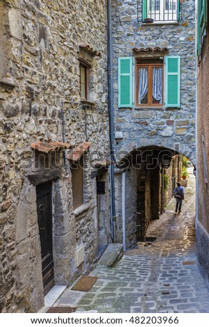 Narrow street in the old town in France.