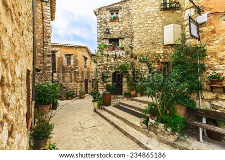 Narrow street in the old village Tourrettes-sur-Loup in France. - stock photo