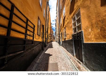 Narrow street of Gamla Stan, Stockholm old town, Sweden - stock photo