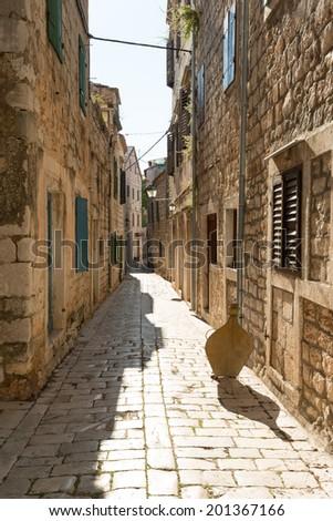 Narrow street of historic Stari Grad, Hvar island, Croatia - stock photo