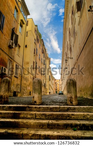 Narrow street of medieval architecture in Rome - stock photo