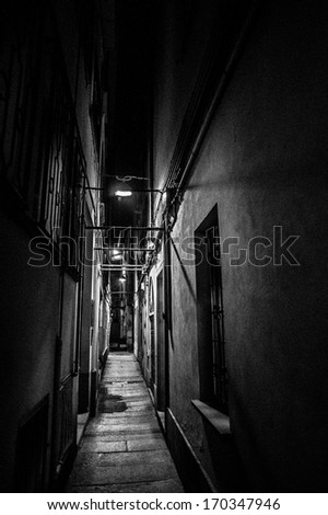 narrow street of the city - stock photo